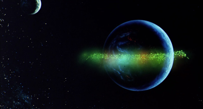 落下軌道をそれていくアクシズとサイコ・フレームの光